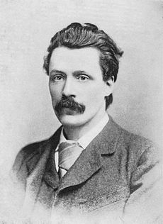 Gissing, sporting a jolly fine moustache...
